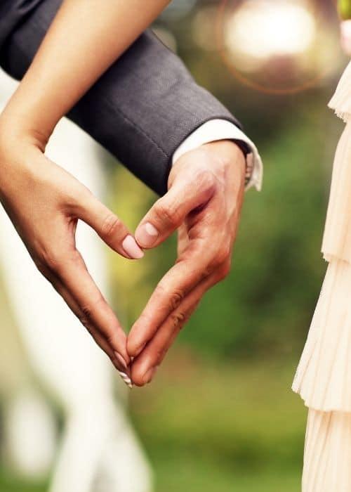 couple hands making a love shape